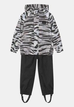 Molo - WHALLEY SET - Pantalones impermeables - tiger black