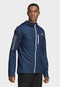 adidas Performance - OWN THE RUN HOODED WINDBREAKER - Chaqueta de entrenamiento - blue