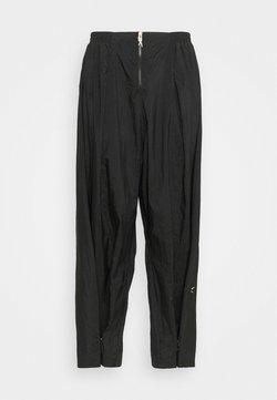 Reebok - PANT IN - Pantaloni sportivi - black