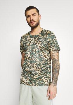 adidas Performance - TEE MEN - T-shirt imprimé - hazy beige