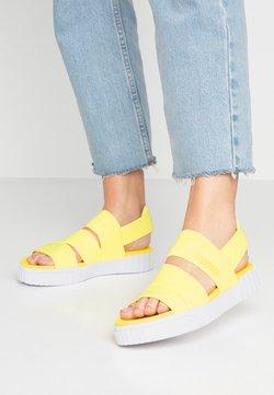 Puma - CALI X SG - Korkeakorkoiset sandaalit - soft fluo yellow/white