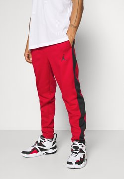 Jordan - AIR THERMA PANT - Jogginghose - gym red/black