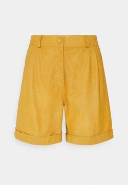 DEPECHE - Shorts - yellow