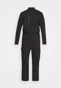 Diesel - P-DEVO PANTALONI - Jumpsuit - black