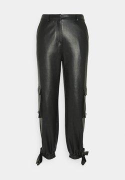 NA-KD - TIED HEM PANTS - Cargo trousers - black