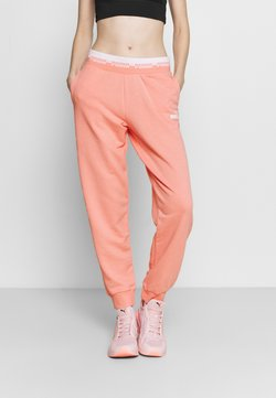 Puma - AMPLIFIED PANTS - Jogginghose - apricot blush