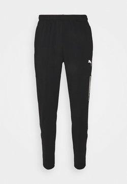 Puma - TEAMLIGA TRAINING PANTS PRO - Jogginghose - black/white