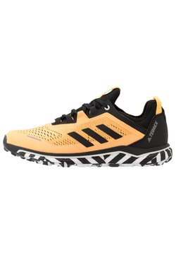 adidas Performance - TERREX AGRAVIC FLOW - Trail hardloopschoenen - solar gold/core black/footwear white