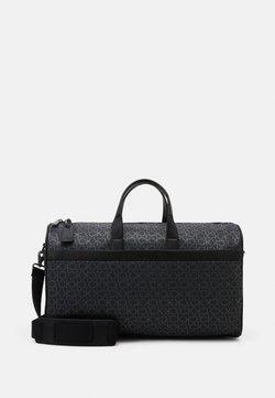 Calvin Klein - DUFFLE BAG - Viikonloppukassi - black