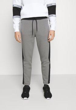 Calvin Klein - SOLID MIX BACK LOGO PANTS - Jogginghose - grey