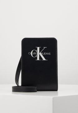 Calvin Klein Jeans - MONOGRAM POUCH BAG - Torba na ramię - black