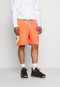 Nike Sportswear - Pantaloni sportivi - turf orange