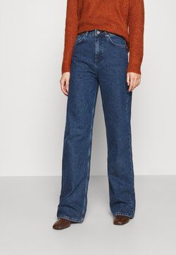NU-IN - STEFANIE GIESINGER X nu-in HIGH WAIST EXTRA LONG LOOSE FIT JEANS - Jeans relaxed fit - mid blue wash
