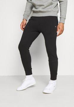 Calvin Klein Golf - PLANET - Jogginghose - black