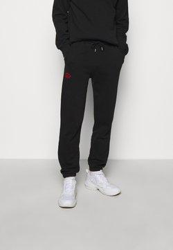 Han Kjøbenhavn - Jogginghose - faded black/red
