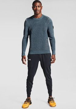 Under Armour - FLY FAST - Jogginghose - black