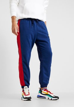 Nike Sportswear - AIR PANT MIX - Jogginghose - blue void/university red/white/black