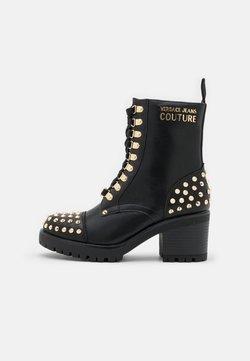 Versace Jeans Couture - Botki kowbojki i motocyklowe - nero