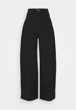 Monki - NANI PALAZZO - Flared Jeans - black dark