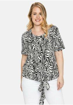 Sheego - T-Shirt print - weiß-schwarz