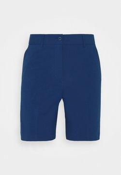 J.LINDEBERG - GWEN LONG GOLF SHORT - Träningsshorts - midnight blue