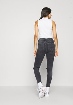 American Eagle - HIGHEST RISE JEGGING - Jeggings - black in the dayz