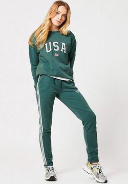 America Today - CELINA - Jogginghose - bottle green