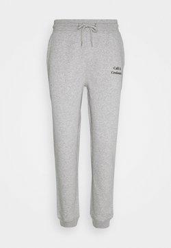 Les Petits Basics - JOGGING PANTS CAFE CROISSANT UNISEX - Jogginghose - grey/black