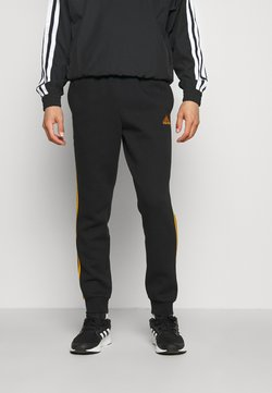 adidas Performance - 3 STRIPES  ESSENTIALS - Jogginghose - black/semi solar gold