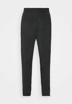 Fila - LACI PANTS - Verryttelyhousut - black