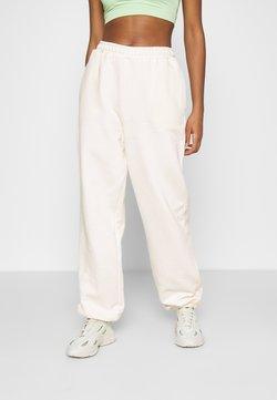NA-KD - NA-KD X ZALANDO EXCLUSIVE - LOOSE FIT PANTS - Jogginghose - off-white