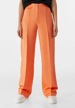 Bershka - Spodnie materiałowe - orange