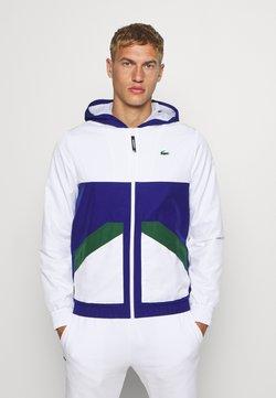 Lacoste Sport - TENNIS JACKET - Veste de survêtement - white/cosmic-green