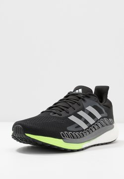 adidas Performance - SOLAR GLIDE BOOST SHOES - Zapatillas de running neutras - core black/silver metallic/signal green