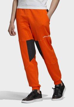 adidas Originals - ADVENTURE FIELD JOGGERS - Jogginghose - orange