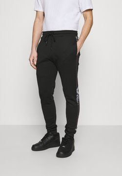 Criminal Damage - CHEVRON JOGGER - Jogginghose - black/white