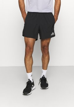 adidas Performance - OWN THE RESPONSE AEROREADY - Krótkie spodenki sportowe - black