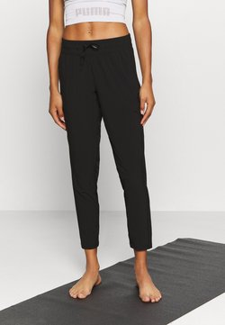 Puma - STUDIO PANT - Pantalon de survêtement - black
