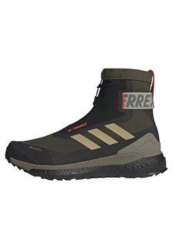 adidas Performance - TERREX BOOST COLD.RDY PRIMEKNIT HIKING SHOES - Obuwie hikingowe - feagry/savann/solred