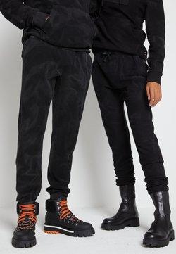 Tommy Hilfiger - LEWIS HAMILTON UNISEX GMD SWEATPANTS - Spodnie treningowe - black