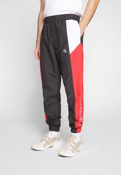 Calvin Klein Jeans - COLOR BLOCK TRACK PANT - Jogginghose - black/white/red