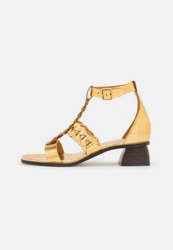 sandro - Sandaalit nilkkaremmillä - gold