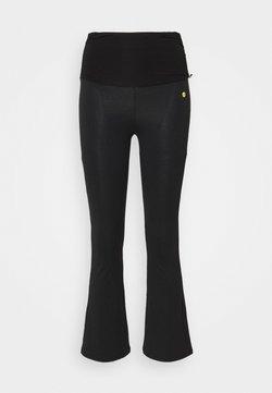 Deha - FLARED 7/8 PANTS - Jogginghose - black