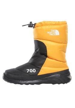 The North Face - M NUPTSE BOOTIE 700 - Snowboot/Winterstiefel - summit gold/tnf black