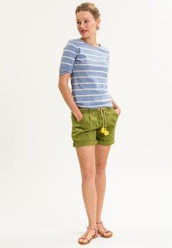 UVR Berlin - MAYANAINA - Shorts - apfelgrün