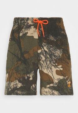 adidas Originals - Pantalon de survêtement - hemp/brooxi/eargrn
