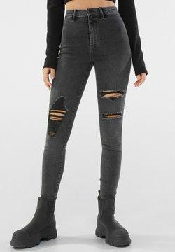 Bershka - MIT RISSEN  - Jeans Skinny Fit - dark grey