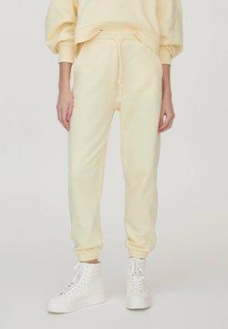 PULL&BEAR - Jogginghose - mottled dark yellow