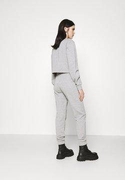 NA-KD - GLITTER - Jogginghose - grey
