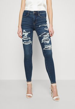 American Eagle - HIGH RISE JEGGING - Jeans Skinny - shadow patched blues